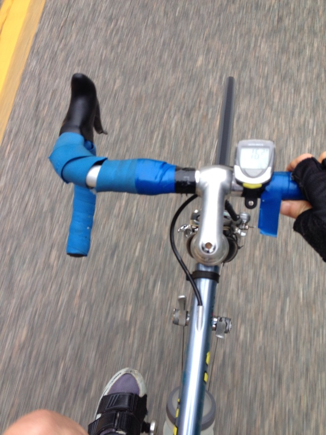 View of bike handlebars with unraveling tape