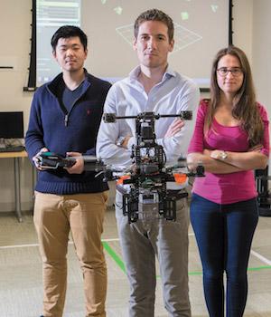 Professor and students test an autonomous drone.